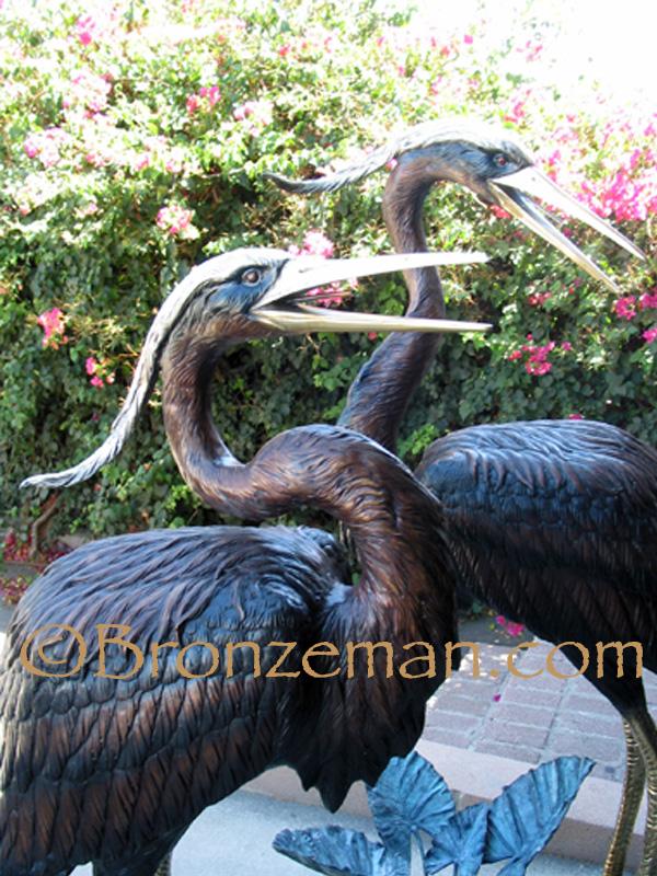 bronze heron statue