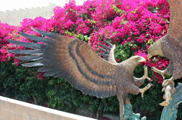 bronze statue of two eagles fighting