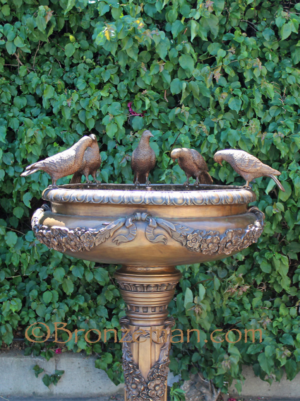 bronze birdbath statue