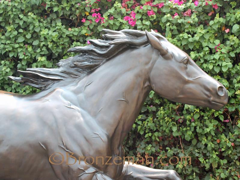 bronze horse running