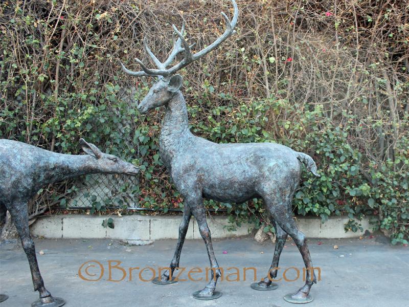 Bronze buck an doe statues