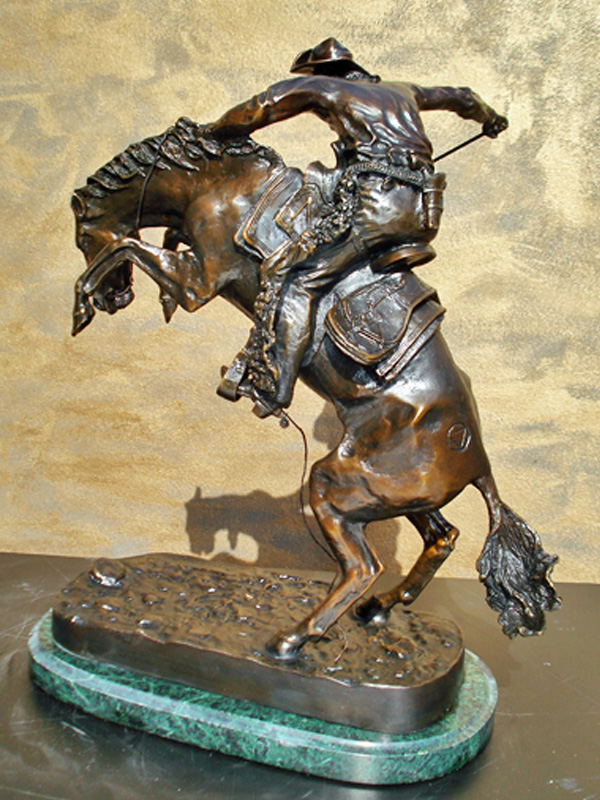bronze remington wooly chaps statue