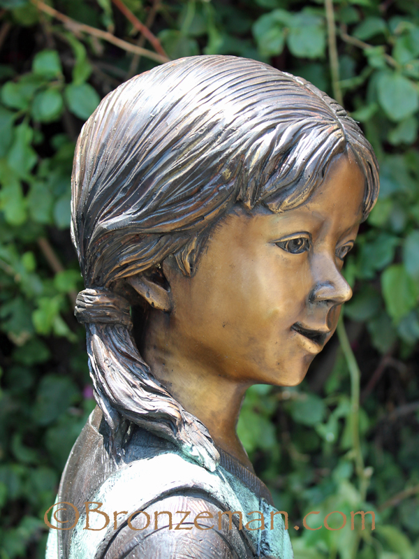 bronze statue of a girl with parrot