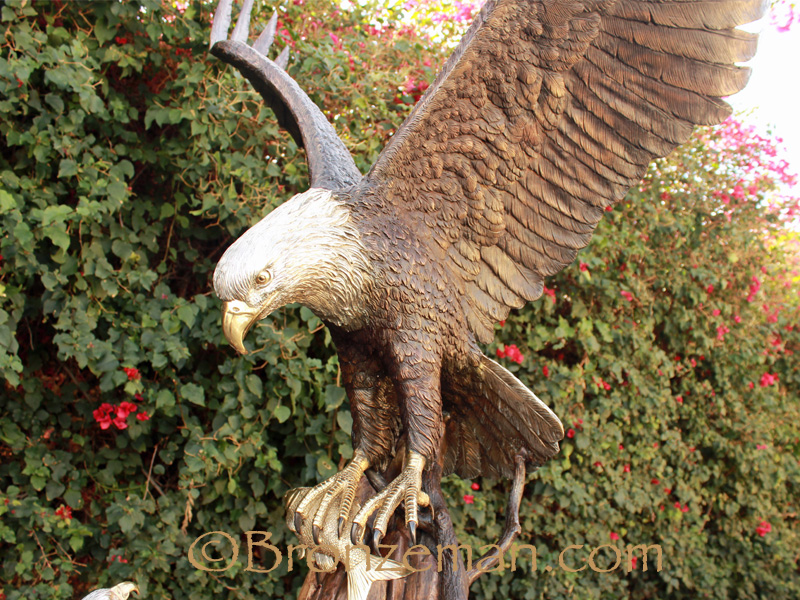 bronze statue of eagle feeding baby