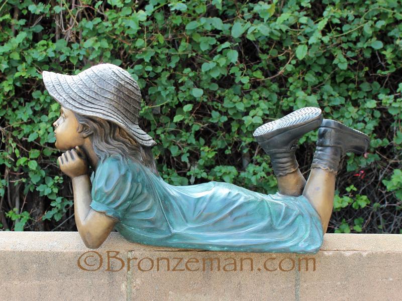 bronze girl statue
