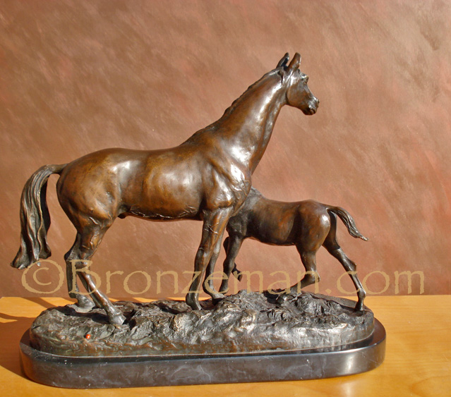 bronze horse statue of a mare and foal