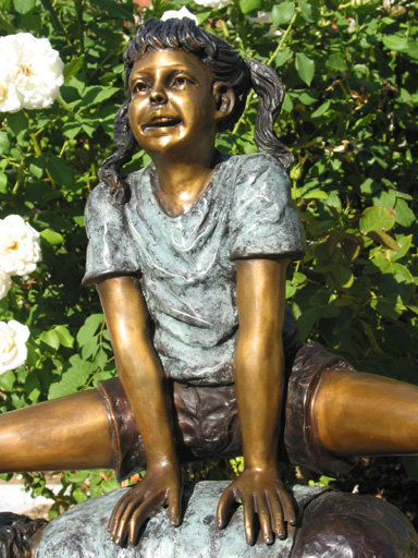 bronze statue of kids playing leap frog