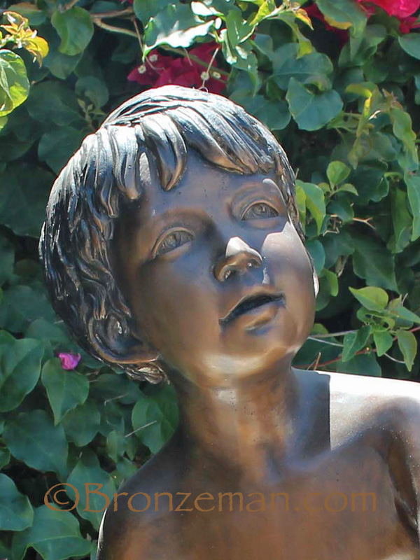 bronze statue of a boy and squirrel