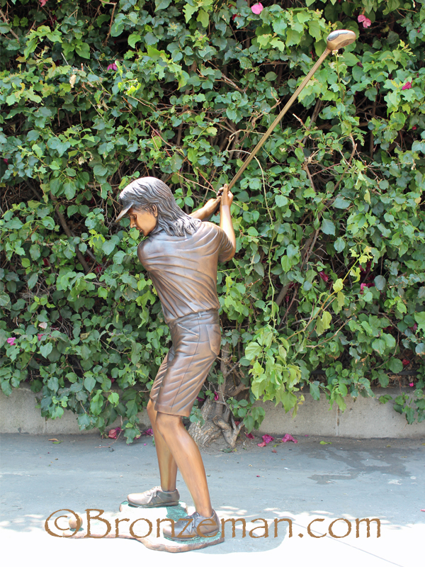 bronze girl golfer statue