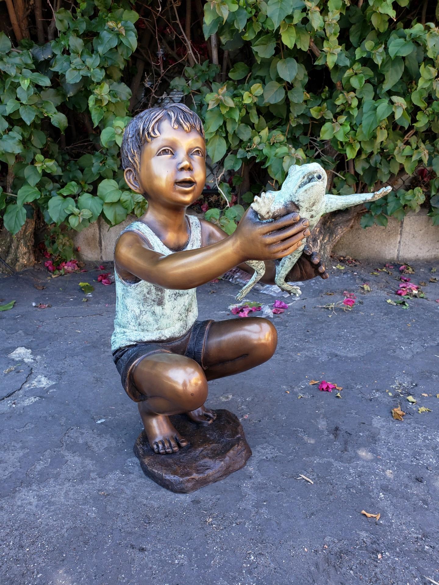 bronze boy statue