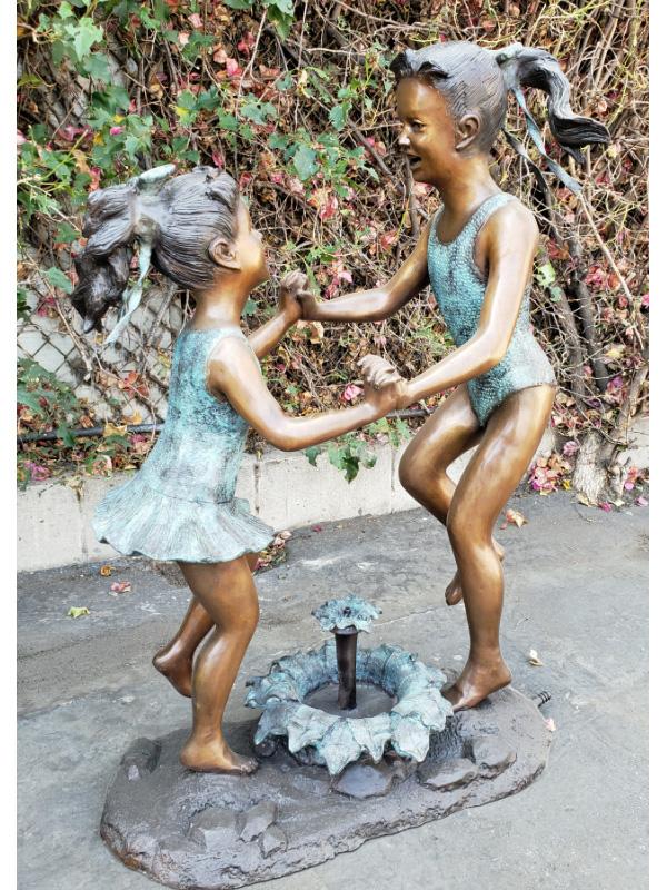 bronze statues of girls dancing