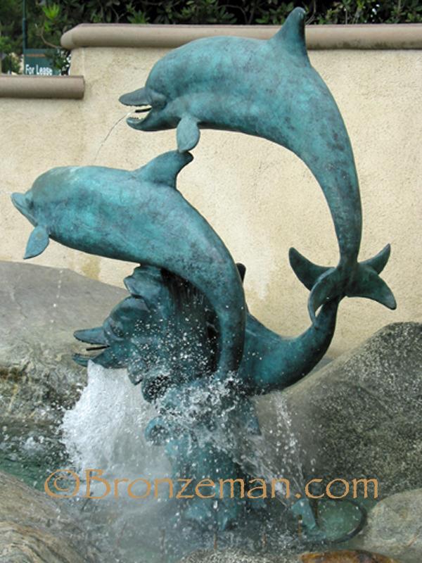 bronze dolphins statue