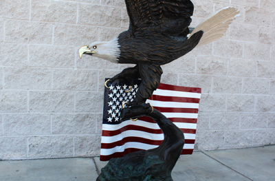bronze statue of eagle with flag