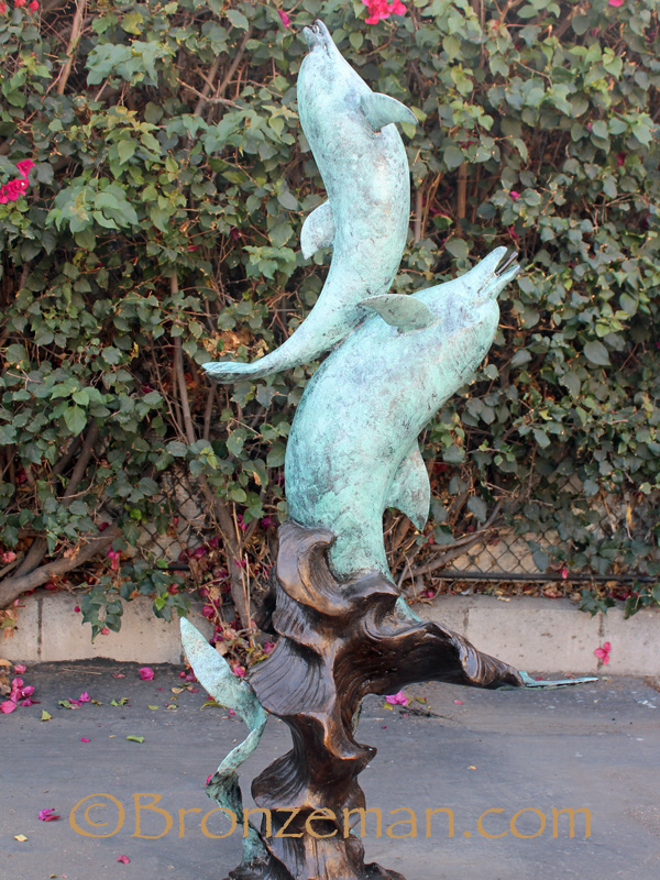 bronze statue of two dolphins