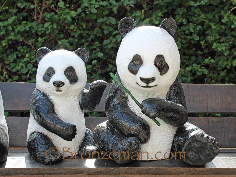 bronze. pandas on bench