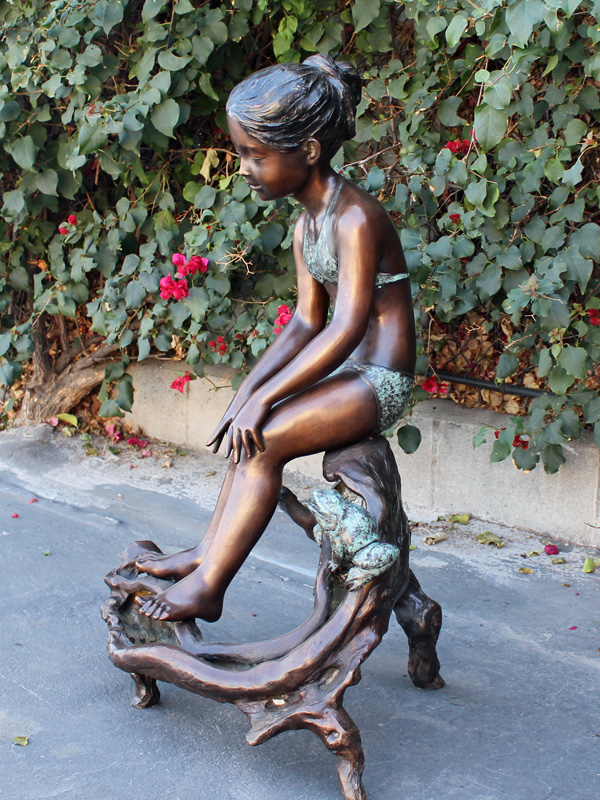 bronze statue of a girl with a frog