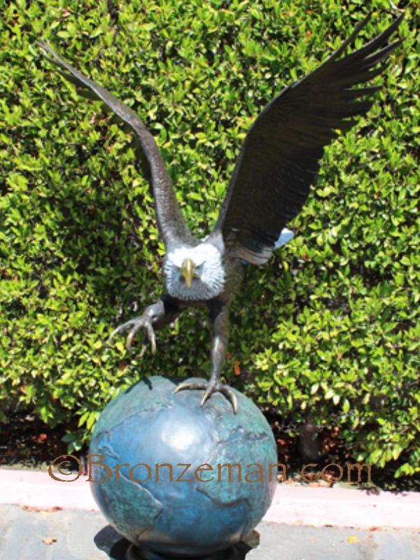 bronze eagle on globe