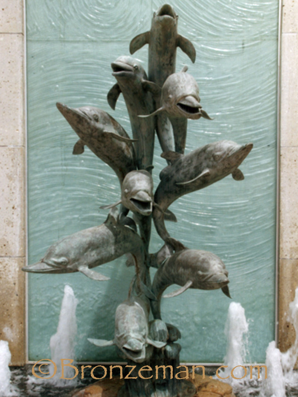 bronze fountain statue of dolphins