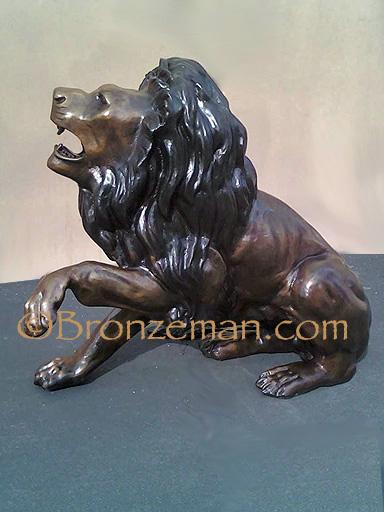 bronze sitting lion statue