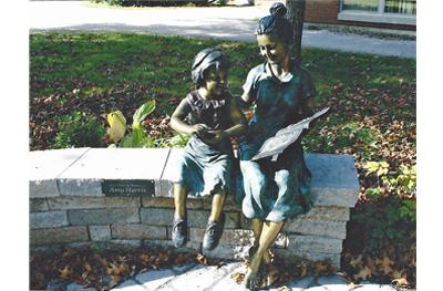 bronze statue of a teacher and child