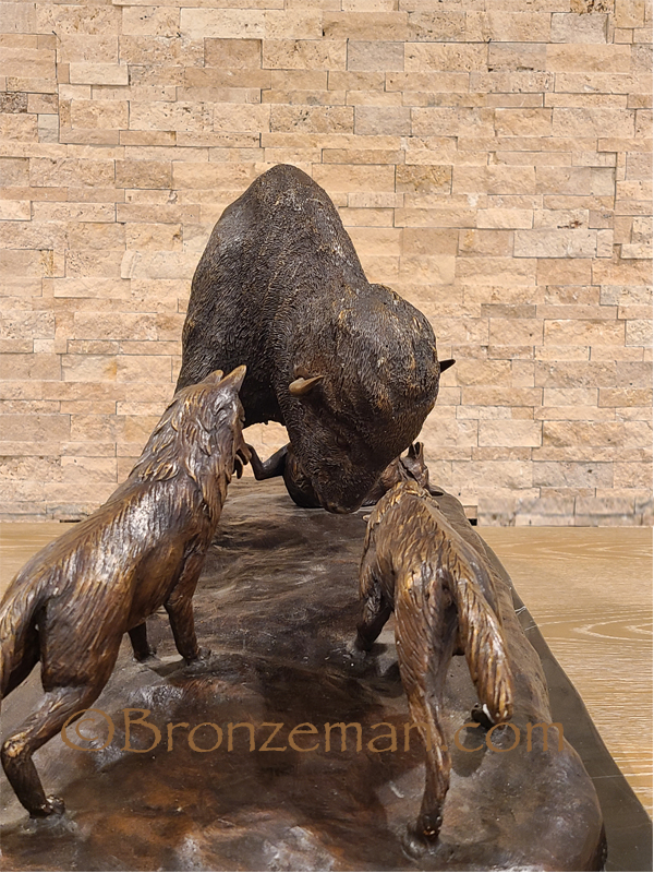 Bronze bison statue with wolves
