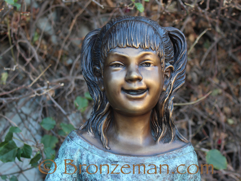 bronze statue of a girl