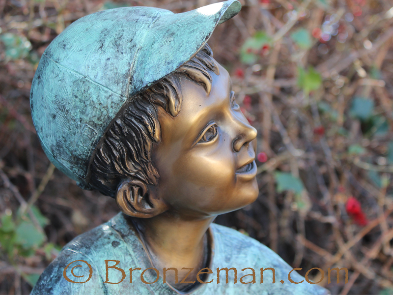 bronze statue of boy with turtle