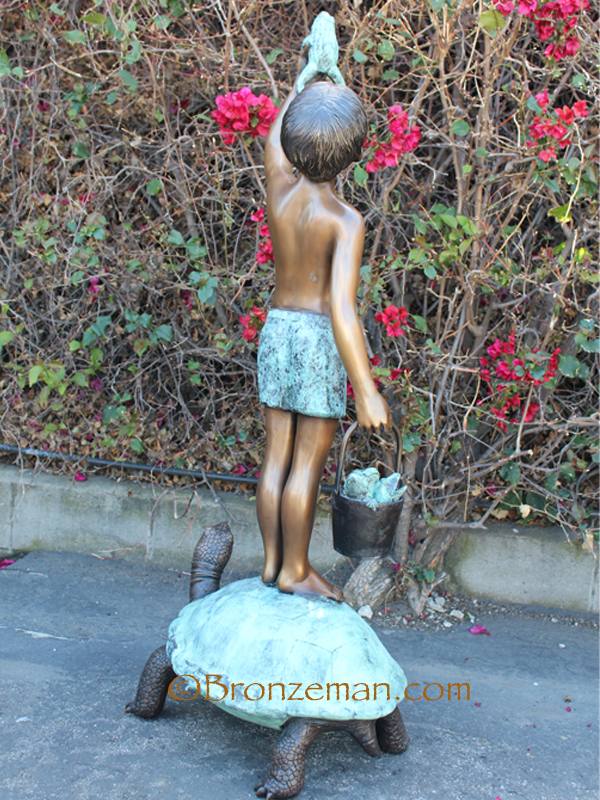 bronze boy with frogs