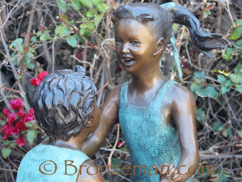 bronze statue of children playing
