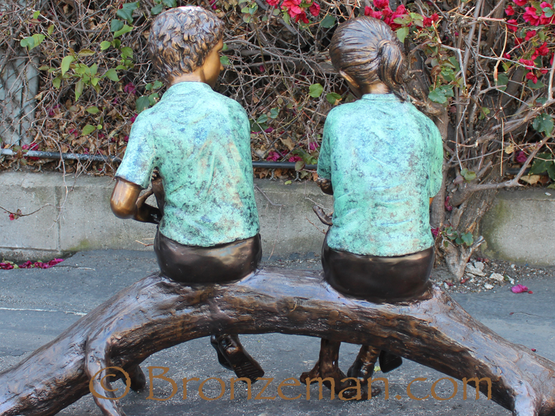 bronze two children on a log