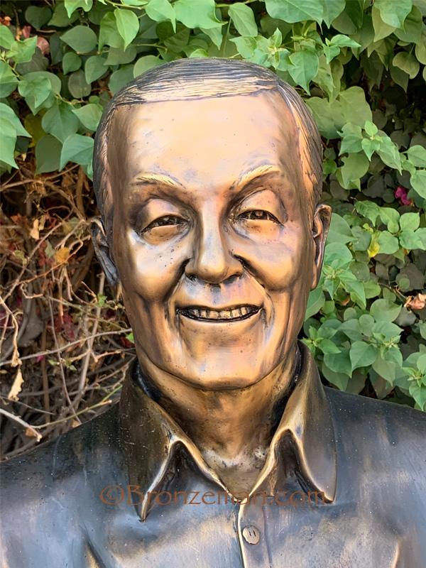 custom bronze statue of man sitting on bench