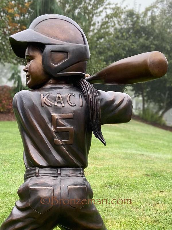 custom bronze statue girl playing softball